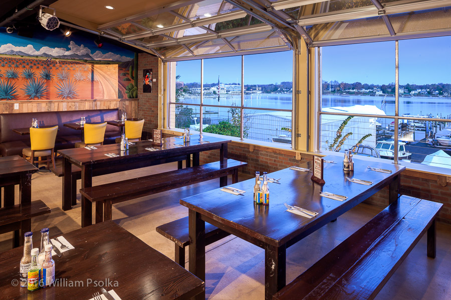Psolka Photography image of rear dining section of 10th Ave. Burrito overlooking Navesink river