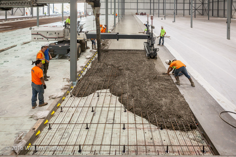 Concrete pour with screed machine by Psolka Photography